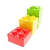 Scala in tre tappe fatta dei blocchetti del mattone della costruzione del giocattolo Immagini Stock Libere da Diritti