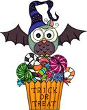 Halloween owl with  trick or treat bag filled with candies Royalty Free Stock Photos
