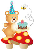 Teddy bear and birthday cake on mushrooms Royalty Free Stock Images