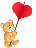 Teddy bear carries heart Stock Photography
