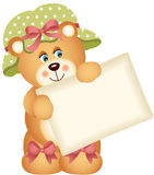 Teddy bear holding a blank sign Royalty Free Stock Photos