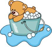 Teddy bear taking a bubble bath Royalty Free Stock Photo
