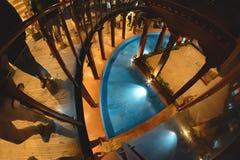 Scalata della scala di legno a spirale Fotografia Stock