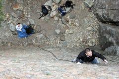 Scalata di roccia di sport delle coppie Fotografie Stock