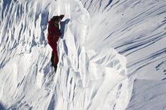 Scalatore della neve Immagine Stock