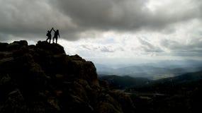 scalatori della sommità, esempi di successo Immagine Stock
