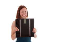 The scale. A young woman with a scale Royalty Free Stock Photography