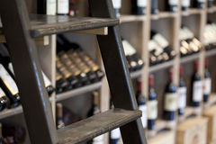 Scale. And bottles of wine in a wine shop, France Royalty Free Stock Photo