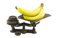 Scale antiche della cucina con le banane Immagine Stock Libera da Diritti