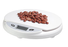 Scale with beans Stock Photo