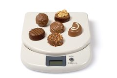 Scale and Chocolate Royalty Free Stock Image