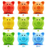 Scale class energy savings efficiency of colorful piggy bank. On white background stock image