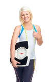 Scale confident woman. Weightloss woman with scale showing diet and exercise concept Royalty Free Stock Photo
