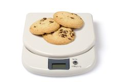 Scale and Cookies. Scale with cookies isolated over a white background. Check other photos in the serie stock photos