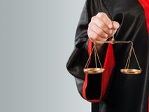Close-up judge with scale at courtroom stock images