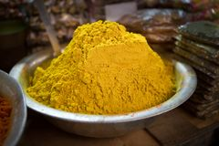 Scale with curry powder on a food market Royalty Free Stock Photo