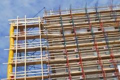 Scale del grattacielo del cantiere di rinnovamento della costruzione dell'impalcatura Fotografia Stock
