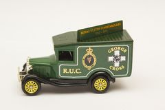 A scale die cast model of a Ford Van in the livery of the old Royal Ulster Constabulary police force. A scale die cast model of a Ford Van in the livery of the Royalty Free Stock Photography