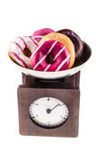 Scale with donuts Royalty Free Stock Images
