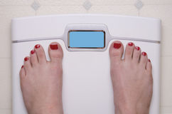 Scale with Female Feet Stock Photos