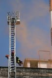 Scale of firefighters for the recovery of wounded during the fir Royalty Free Stock Photos