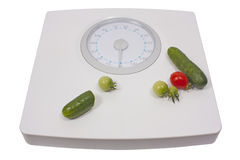 Scale with fresh vegetables for diet Royalty Free Stock Photo