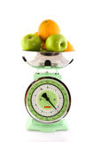 Scale with fruit Stock Photos