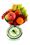Scale with fruit for diet Royalty Free Stock Image