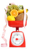 Scale with fruits Stock Image