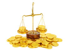 Scale and golden coins Stock Image
