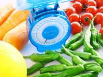 Scale for health. Kichen scale and colorful vegetables Stock Photography