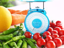 Scale for health. Kichen scale and colorful vegetables Stock Photo
