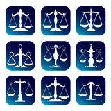 Scale of justice. On the white and blue background Royalty Free Stock Photography