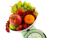 Scale for the kitchen with fruit Stock Photography