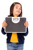 Scale. Little girl holding a scale Stock Photography