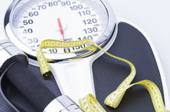 Scale, Measuring Tape, and Dumbbells Royalty Free Stock Image