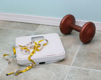 Scale, measuring tape and dumbell Royalty Free Stock Photos