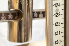 Scale with the meter to measure the weight and height of patient Stock Image