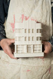 Scale Model of Architectural Building Held by Two Hands Royalty Free Stock Images