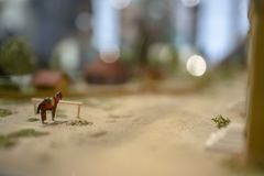 Scale model equine horse on a farm scene. On a macro still royalty free stock photos