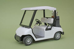 Scale Model Golf Cart. Golf cart, approximately 1:18 scale die-cast model, green background Royalty Free Stock Images