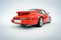 Porsche 911 Carrera RS 1:18 AutoArt model. 1:18 Scale model of an Porsche 911 Carrera Rs from AutoArt Royalty Free Stock Photography