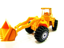 Scale model tractor loader for kid. Scale model tractor, complete with a front loader, isolated on white background Royalty Free Stock Photography