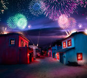 Scale model of a typical mexican village at night with fireworks Royalty Free Stock Image