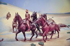 Scale Models, Action Figures soldier riding a horse in a war zone. Stock Image