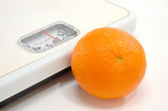 Scale and Orange stock image