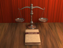 Scale and patent law book on the table Royalty Free Stock Photography