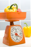 Scale And Pepper. Scales and pepper in the kitchen Royalty Free Stock Image