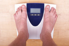 Scale with person Royalty Free Stock Photography
