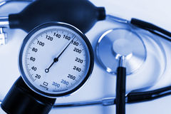 Scale of pressure and stethoscope Royalty Free Stock Image
